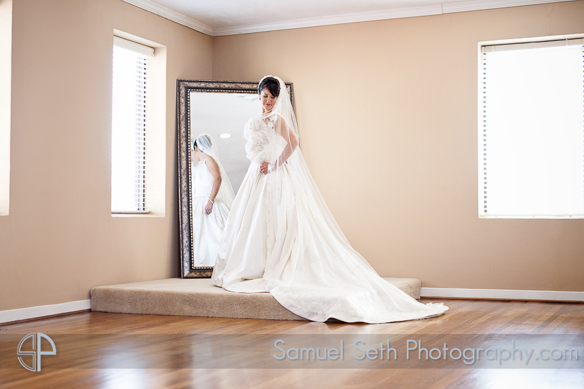 Bride Looking in Mirror The heights villa Bridal Portraits